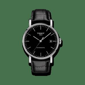 Tissot Everytime Swissmatic Armbanduhr mit schwarzem Zifferblatt und Armband aus Kalbsleder mit Krokodilprägung.