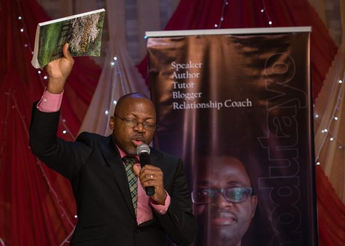 Pastor Ikide Ekong handing it over