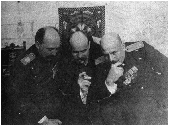 Dragutin Dimitriević, right, with two assistants