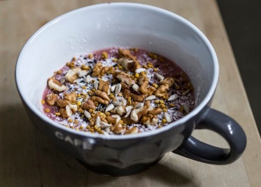 Image of seeds, nuts and blended berries in a coffee cup