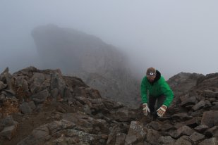 Nearing the summit and breaking through the clouds.