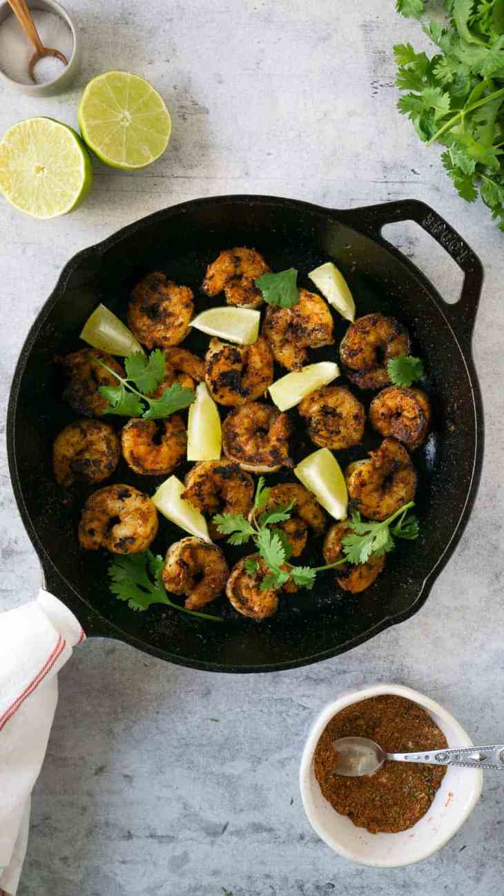 blackened shrimp in a cast iron pan