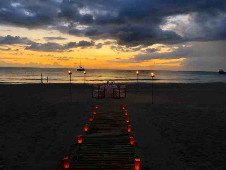 Private dinner on the beach at Couples Swept Away in Negril, Jamaica