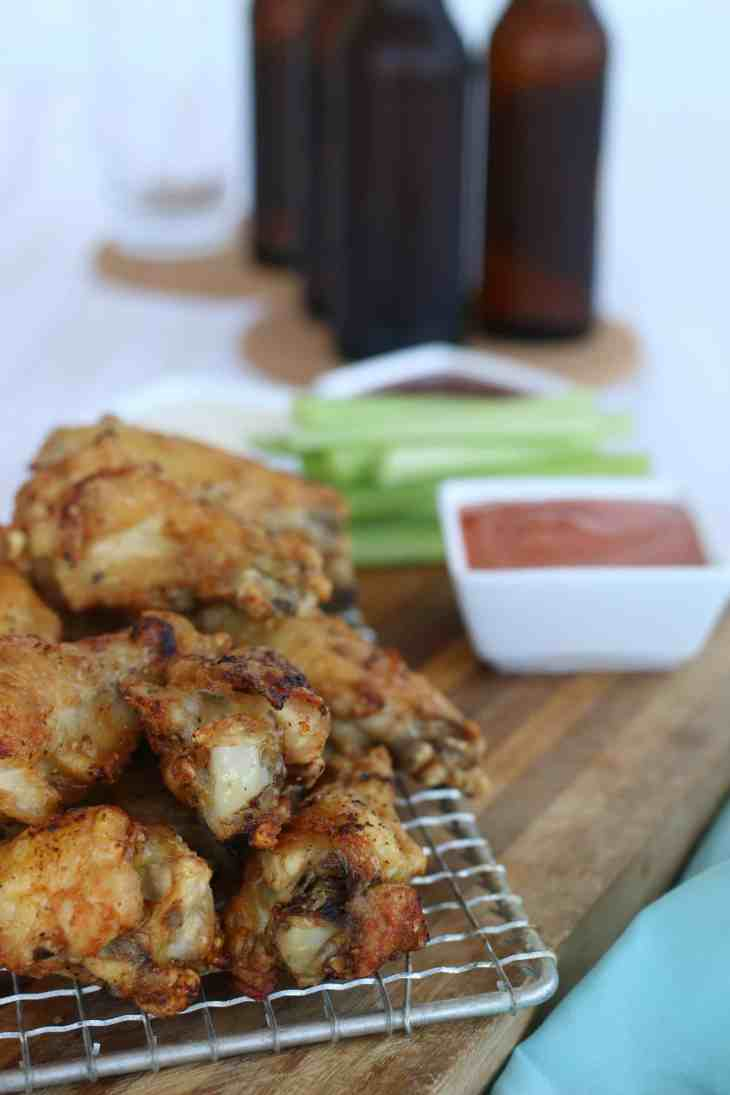 Air-fryer chicken wings with wing sauce.