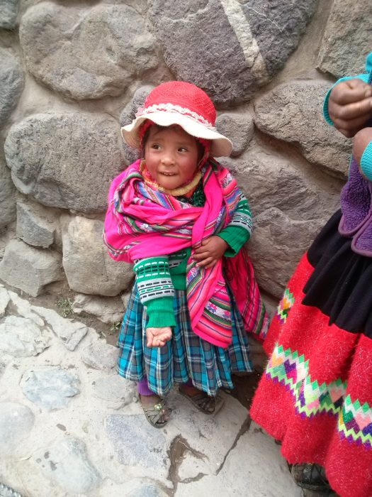 K in Motion Travel Blog. Adventures In Southern Peru. Local Girl in Traditional Peruvian Attire, Ollantaytanbo, in the Andes, Peru