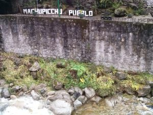 K in Motion Travel Blog. Adventures In Southern Peru. Aguas Calientes. Machu Picchu Pueblo Sign, in the Andes, Peru