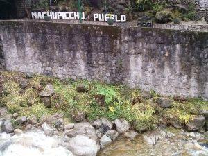 K in Motion Travel Blog. Adventures In Southern Peru. Aguas Calientes. Machu Picchu Pueblo Sign, in the Andes, Peru