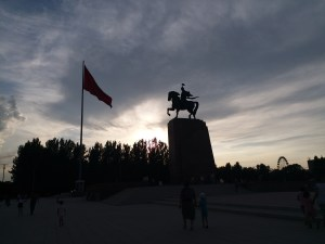 K in Motion Travel Blog. The Quirks of Eastern Kyrgyzstan. Bishkek City Centre. Horse and Flag