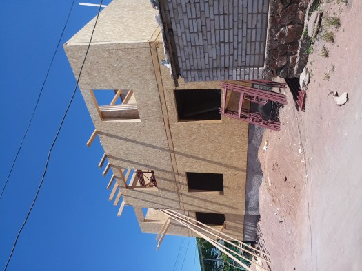 K in Motion Travel Blog. The Quirks of Eastern Kyrgyzstan. Chipboard for Construction at Kadji-Sai. Near Issyk-Kul.
