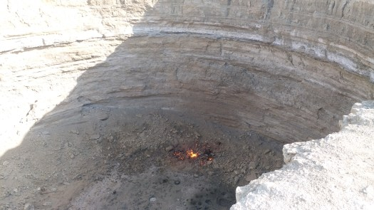 K in Motion Travel Blog. Travel to Turkmenistan - Frontier to Fire. Smaller Crater with a Small Fire Near Darvaza