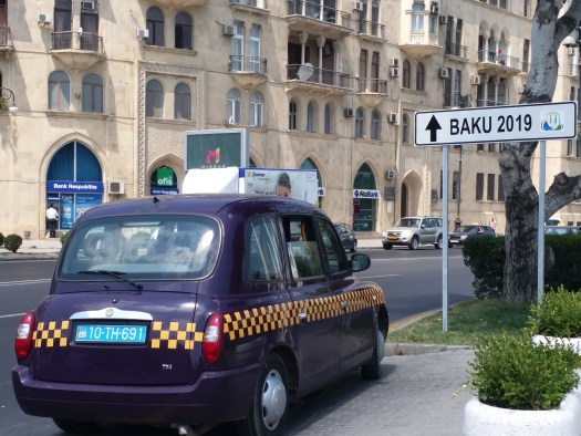 K in Motion Travel Blog. Beautiful Baku. Purple Taxi