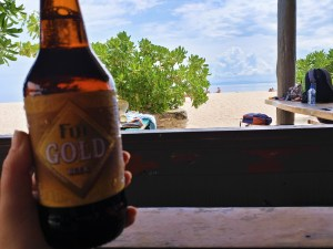 K in Motion Travel Blog. Friendliness and Festivities in Fiji. Fiji Beer at Beach Bar at Beachcomber