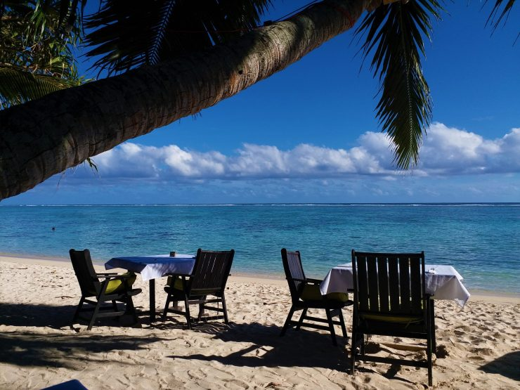K in Motion Travel Blog. The Captivating Cook Islands. Resort Tables On The Beach
