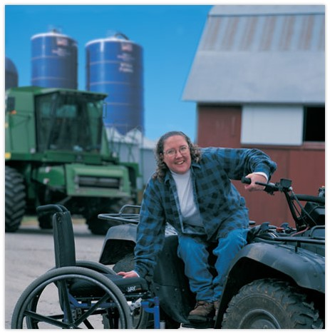 Woman moving from accessible four-wheeler to chair
