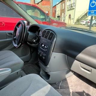 front of interior showing black steering wheel and dark gray interior panels
