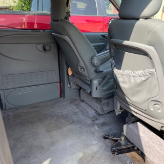 middle of the van showing the backside of the front drive and passenger seat