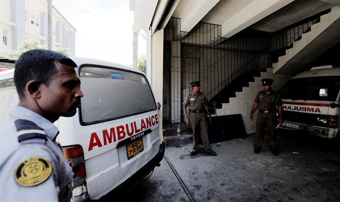 Ambulance carrying victims of Sri Lanka bombings backs into police morgue in Colombo