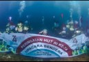 Karyawan Amman Mineral Kibarkan Bendera Merah Putih di Bawah Laut Perairan Teluk Benete