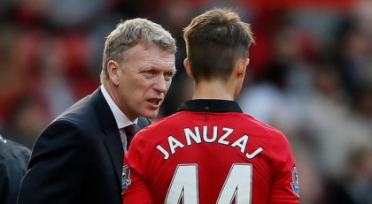 Manchester United manager Moyes talks to Januzaj during their English Premier League soccer match against Southampton at Old Trafford in Manchester