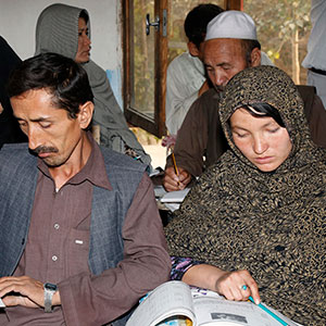 Afghan couple studying together.