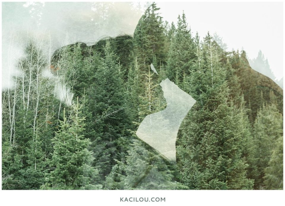 Double Exposure of Couple in Mountains