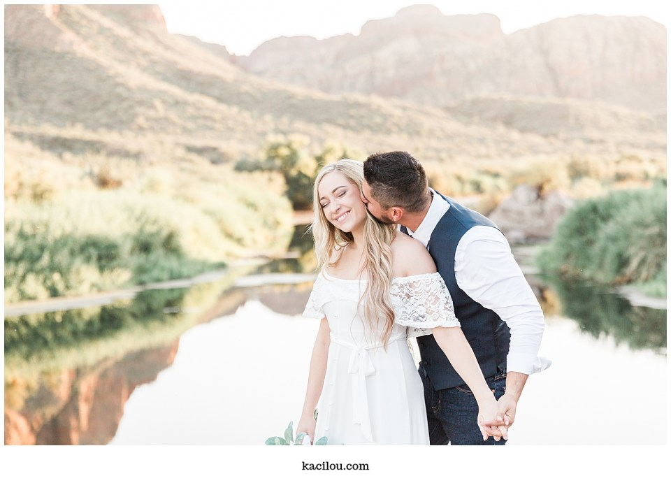 Salt river elopement photo of bride and groom overlooking river