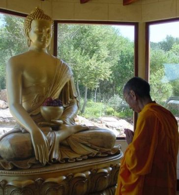 Geshe-la prostrating to Buddha