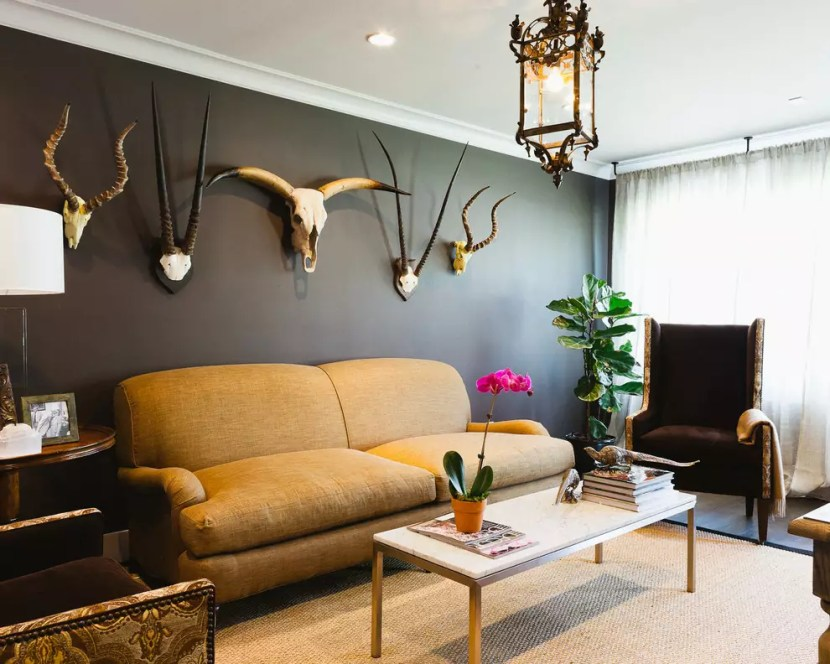Sumptuous-Cow-Skull-convention-Houston-Eclectic-Living-Room-Decorating-ideas-with-armchair-black-black-wall-coffee-table-dark-painted-wall-lantern-plant-side-table-sisal