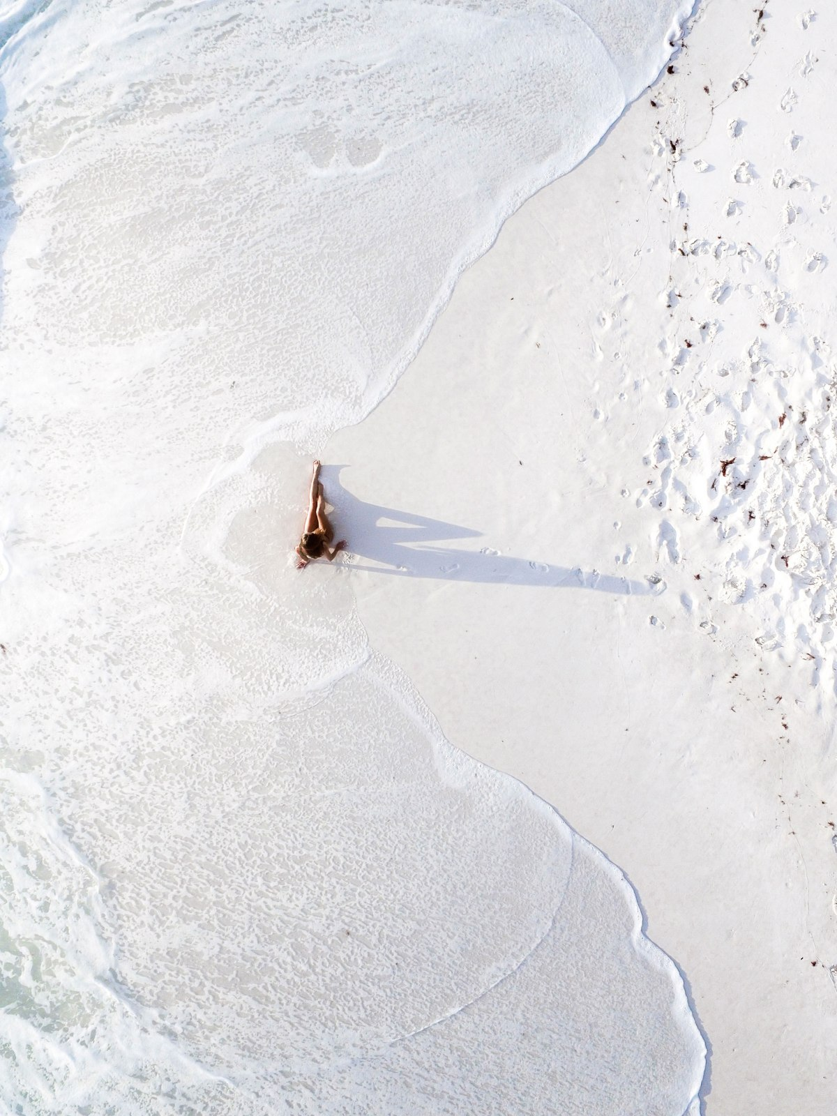Drone Photo Of Girl On Whitest Sand In The World