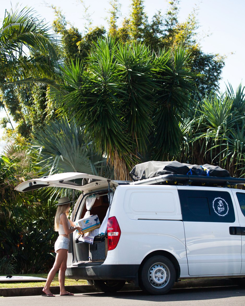 Girl Packing Car With Palm Tree Backdrop