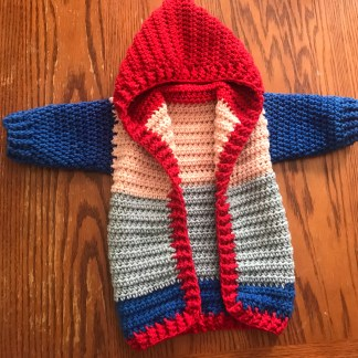 red blue and pink hooded baby jacket