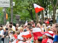 A crown waving Polish flags in Chicago