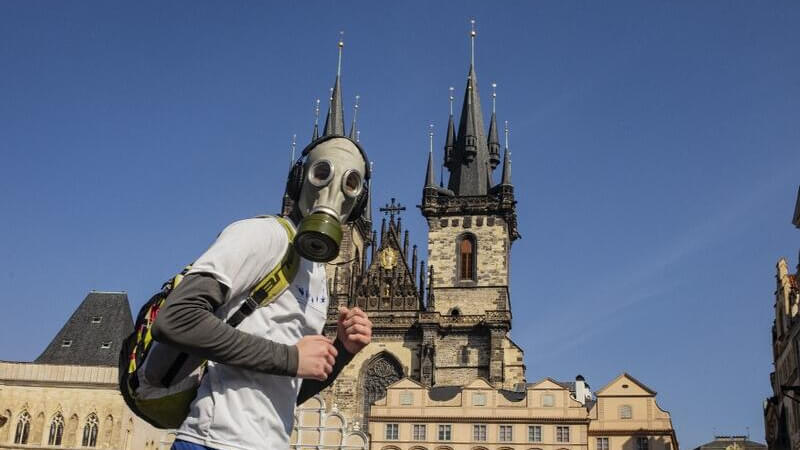 Man with face-mask on Prague Old Town Square