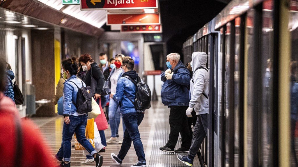People wearing face-masks in the Budapest metro