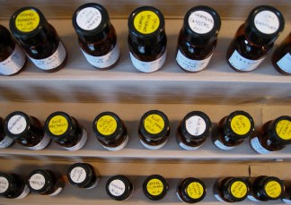 Essential oils on Viktoria Minyas organ, distilled in 10% alcohol. You can see various types of orange-related oils on the top shelf, rose on the middle, and things like vetiver on the bottom. Photo: my own.