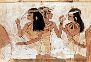 Ancient Egyptians wearing perfume cones on the head. Source: avaroma.com