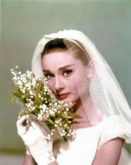 Audrey Hepburn with a muguet bouquet. Source: frenchweddingstyle.com