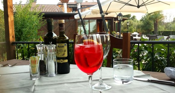 Campari soda in our little, private, elevated dining area, tucked away in a charming gazebo at the end of the Osteria's garden. Photo: my own.