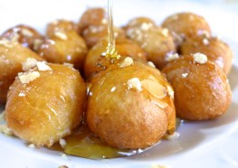 Loukoumades drizzled with honey . Source: egyptianstreets.com