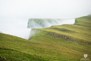 Mist rises from the cliffs on Mykines in the Faroe Islands.