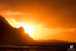 Mount Makana sunburst at sunset on the north shore of Kauai
