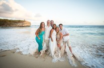 Family portraits at Shipwrecks Beach, Poipu Kauai – getting their feet wet!
