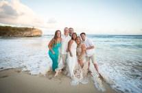 Family portraits at Shipwrecks Beach, Poipu Kauai – getting their feet wet!