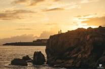 Surprise Proposal on the cliffs of Shipwrecks Beach, Kauai