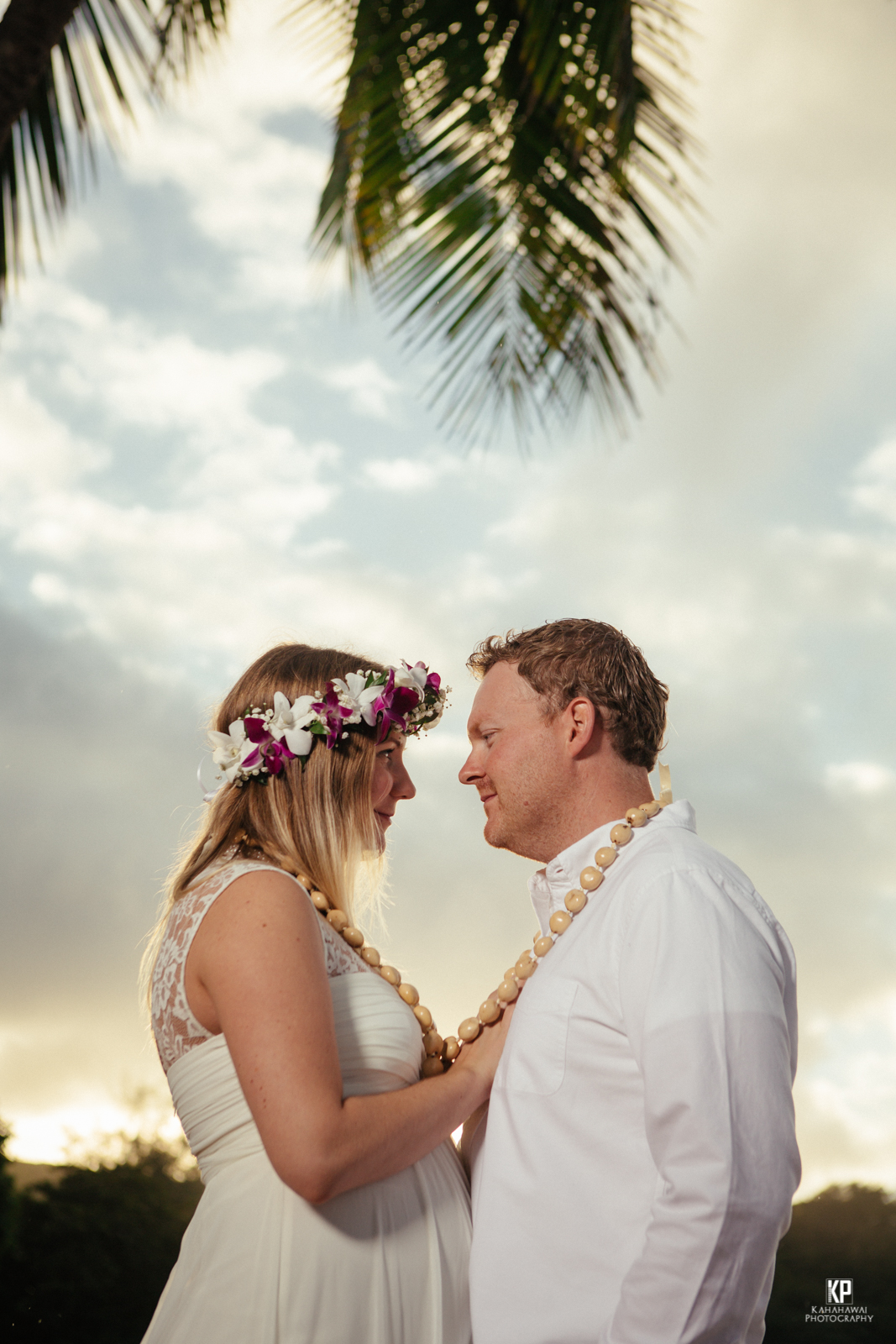 Kauai Photographer captures a sunset beach wedding on Anini Beach