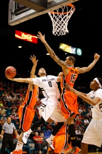 Sophomore guard Askia Booker attempts a layup as Oregon State's Eric Moreland tries to block the shot during a Pac-12 Tournament game at the MGM Grand Garden Arena in Las Vegas on Wednesday, March 13, 2013. (Kai Casey/CU Independent). (Kai Casey/CU Independent)