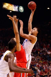 UCLA's Kyle Anderson shoots over Arizona's Brandon Ashley during a Pac-12 Tournament semifinal game at the MGM Grand Garden Arena in Las Vegas on Friday, March 15, 2013. (Kai Casey/CU Independent)