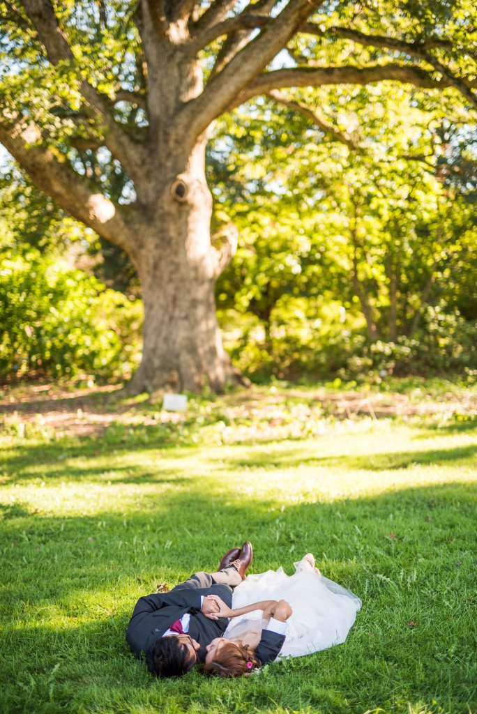 laying down under a tree Kaitlyn Ferris photography garden wedding