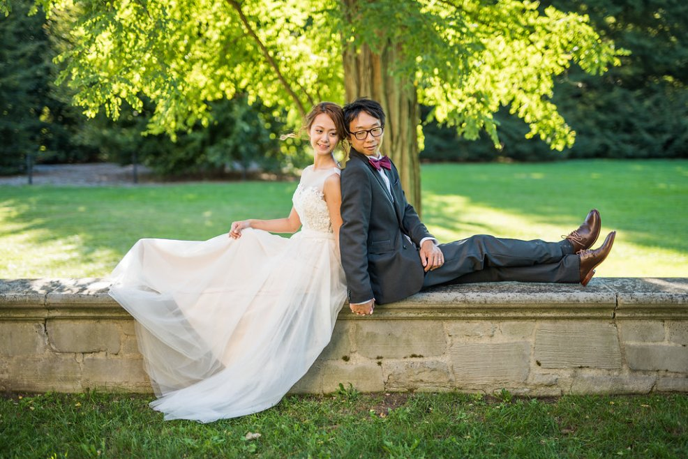 bride and groom sitting Kaitlyn Ferris photography garden wedding