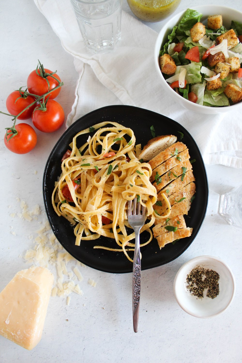 overhead view of the healthier cajun chicken pasta with fork in the plate as if a bite was taken.